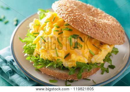 breakfast sandwich on bagel with egg cheese lettuce