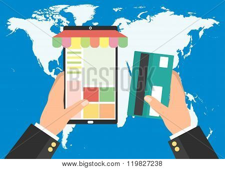Businessman Holding Tablet Smart Phone And Credit Card For Online Shopping On World Map Background.