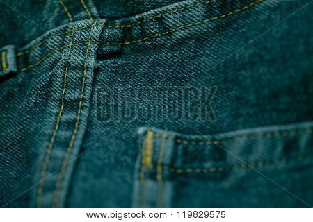 blue jeans stitched with white thread