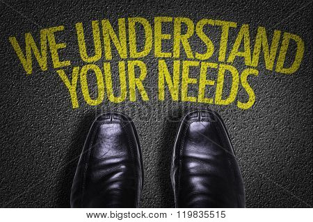Top View of Business Shoes on the floor with the text: We Understand Your Needs