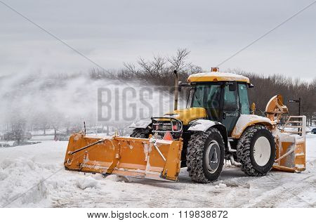Snowblower Track Cleaning A Road.