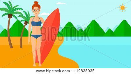 Surfer holding surfboard.