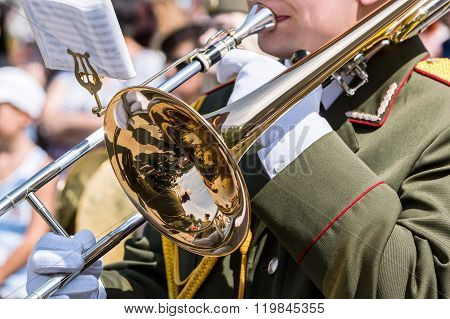 Trombone Player Plays His Trombone On Parade