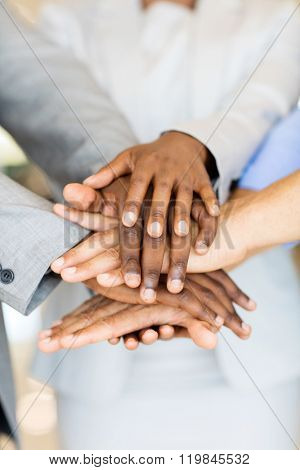 close up of business people hands together