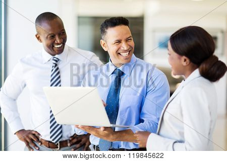group of business people using laptop in modern office
