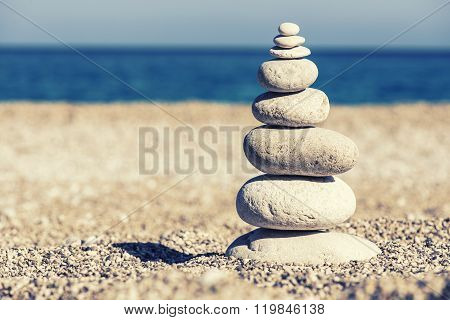 Beautiful Pebble Stack On A Sandy Beach
