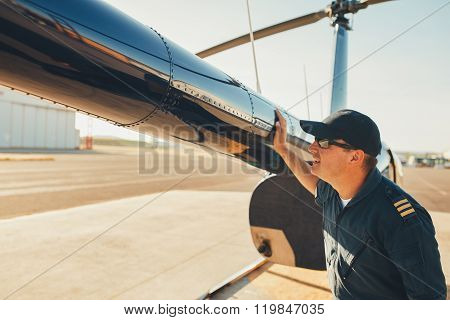 Mechanic Checking Helicopter Before Take Off.