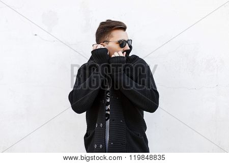 Stylish Man In Black Sweater On White Background.