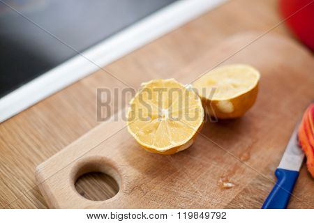 Lemon Halves On Cutting Board