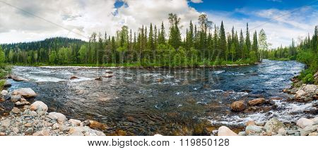 Mountain River with Stones in Siberia. Panoramic view.