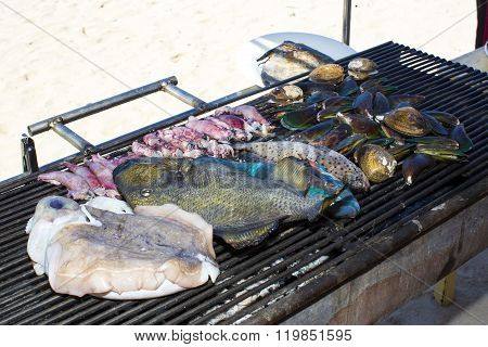 cooking seafood on the grill