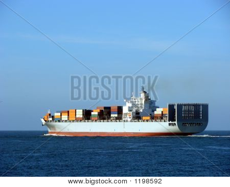 Container Ship Sailing Away at Sea