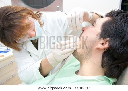 Female Dentist Examining A Patient