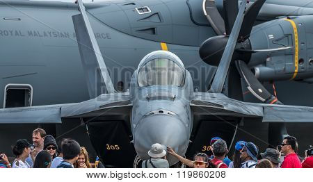 SINGAPORE, FEBRUARY 21, 2016: An F-15 belonging to the US Air Force surrounded by crowds at the 2016 Singapore Airshow. The airshow is the biggest of its kind in Asia.