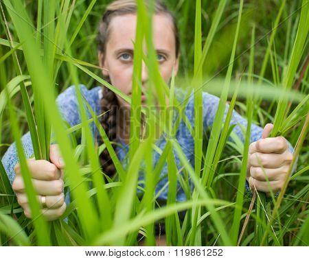 Woman Sneaking Through The Grass.