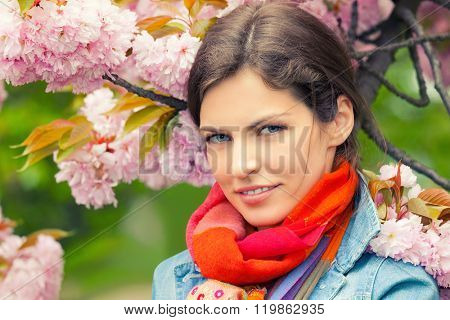 Young beautiful woman in spring garden
