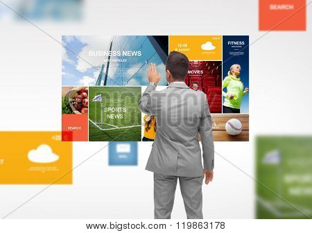 business, people, technology, internet and mass media concept - businessman touching web pages virtual projection from back