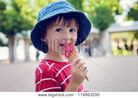 Cute Little Boy, Eating Big Ice Cream In The Park, Smiling At Camera