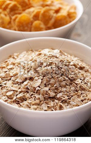 Oatmeal And Cornflakes In White Ceramic Bowl