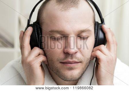 young men listen music in headphones