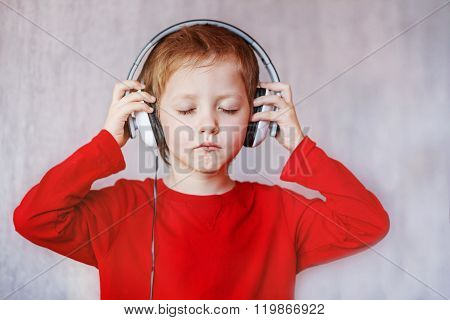 Kid Listen Music At Home.  Child With Headphones.