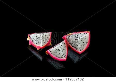 Three Dragon Fruit Fritter On Black Background