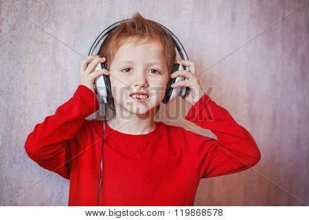 Cute Portrait Boy In Headphones Enjoys Music, Keep Your Hands On