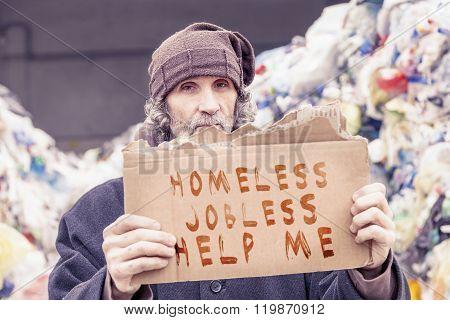 Homeless Show A Help Message Written On A Cardboard