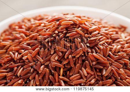 Grain Red Rice In White Ceramic Bowl