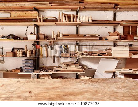 Shelves in woodwork workshop with various wooden items and tools