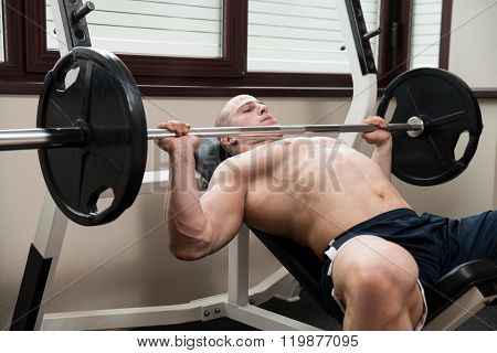 Chest Exercise On Bench Press In Gym