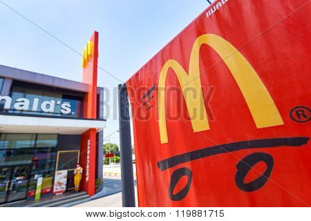 PATTAYA, THAILAND - FEBRUARY 25, 2016: advertisement near McDonald's restaurant. McDonald's is the world's largest chain of hamburger fast food restaurants