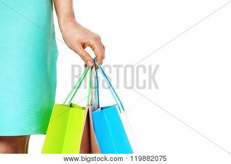 Closeup Of Womans Hand With Shopping Bags.