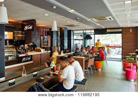 PATTAYA, THAILAND - FEBRUARY 20, 2016: inside of McDonald's restaurant. McDonald's primarily sells hamburgers, cheeseburgers, chicken, french fries, breakfast items, soft drinks, milkshakes, desserts