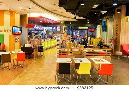PATTAYA, THAILAND - FEBRUARY 22, 2016: inside of McDonald's restaurant. McDonald's primarily sells hamburgers, cheeseburgers, chicken, french fries, breakfast items, soft drinks, milkshakes, desserts