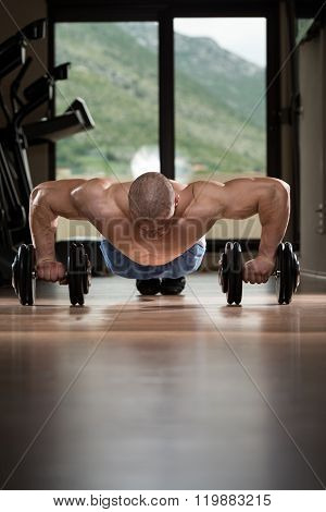Man Doing Pushups On Dumbbells
