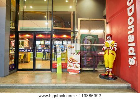 PATTAYA, THAILAND - FEBRUARY 21, 2016: Ronald McDonald character near McDonald's restaurant. Ronald McDonald is a clown character used as the primary mascot of the McDonald's restaurant chain.