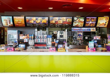 PATTAYA, THAILAND - FEBRUARY 25, 2016: inside of McDonald's restaurant. McDonald's primarily sells hamburgers, cheeseburgers, chicken, french fries, breakfast items, soft drinks, milkshakes, desserts