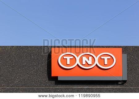 TNT logo sign on a facade