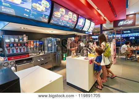 PATTAYA, THAILAND - FEBRUARY 18, 2016: inside of McDonald's restaurant. McDonald's primarily sells hamburgers, cheeseburgers, chicken, french fries, breakfast items, soft drinks, milkshakes, desserts
