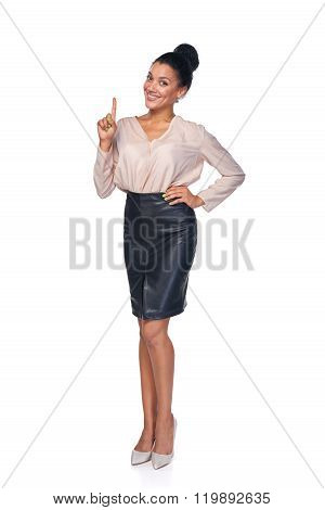Idea. Woman pointing her finger up