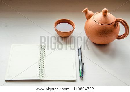 Tea set and a notebook