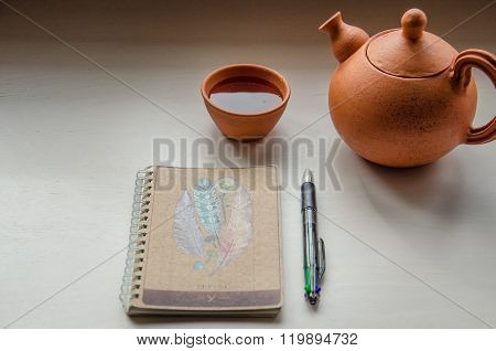 Notebook and a teaset