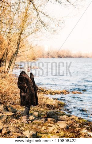 Woman Close To The River In Winter