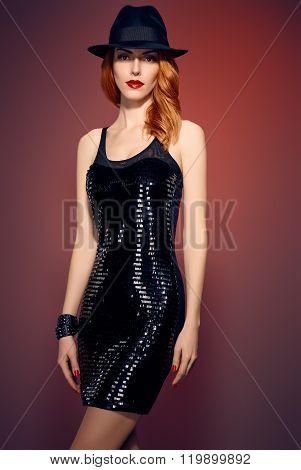 Fashion portrait woman,sequins dress and black hat