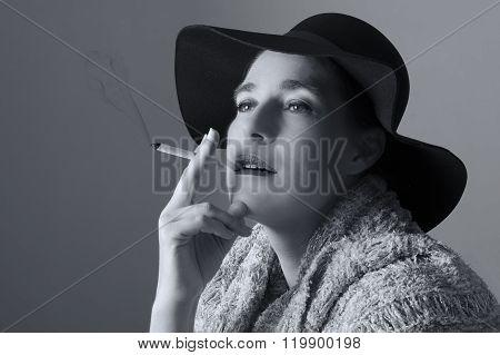 Mature Woman With Black Hat Sit Smoking