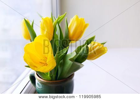 Bunch Of Yellow Tulips On A Window