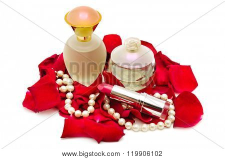 Perfume and pearl necklace in rose petals isolated on white.