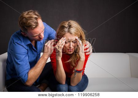 Man trying to calm his girlfriend down