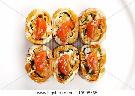 Tasty Japan Omelette Rolls With Tomatoes On White Plate